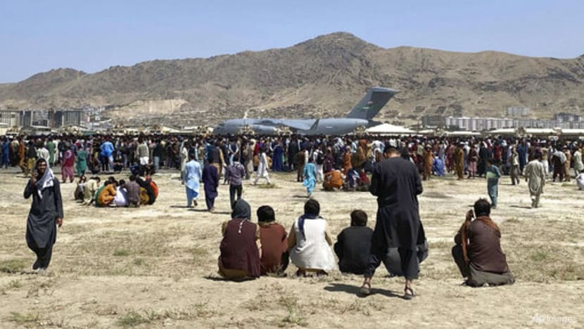 Taliban fire in the air to control crowd at Kabul airport